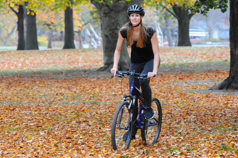Para-Express-woman-riding-through-leaves